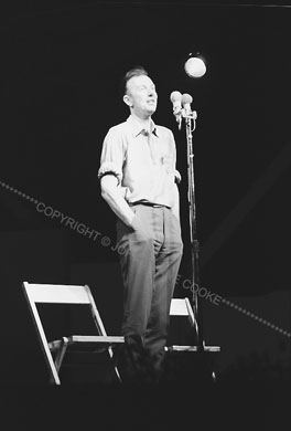 Pete Seeger standing at mike